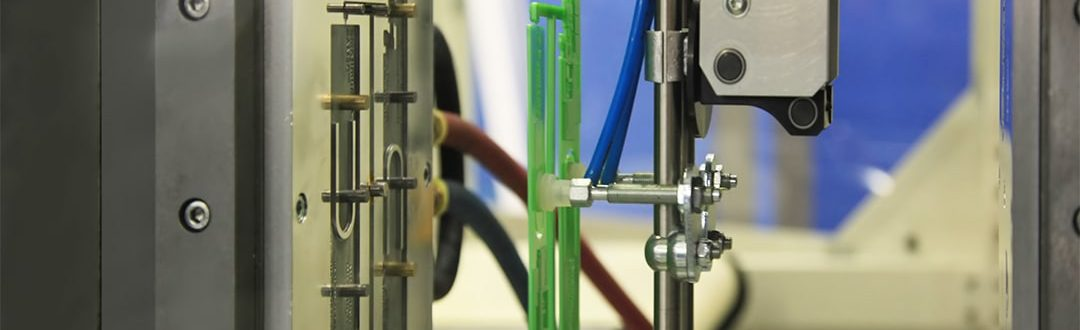 Production of a plastic part by injection moulding