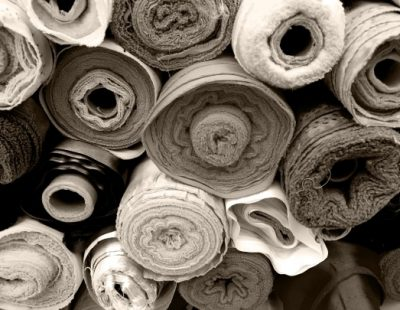 Exhaust air filtration systems and heat recovery for textile finishing